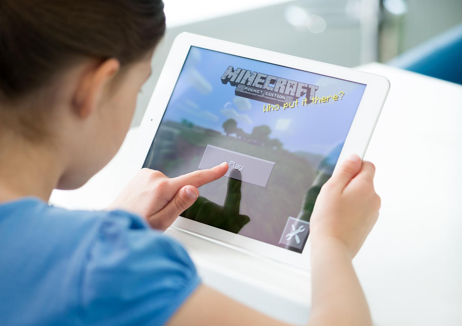 bigstock-Little-Girl-Playing-Minecraft-65636986