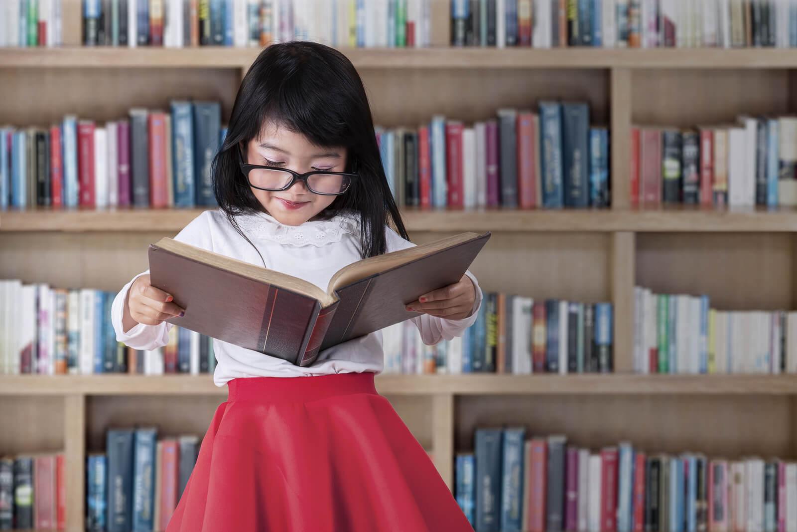bigstock-schoolgirl-reads-book-in-libra-73221412_overlay1-1